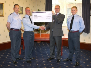 Tim presented the cheque to Michael Bolton from RAFA