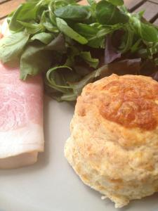 Warm gluten free hot n spicy cheese scones with green salad and local ham.