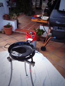 Heat a paella pan or a large frying pan with a generous amount of olive oil.