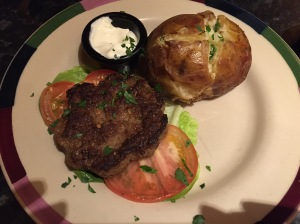This is Frankie and Benny's gluten free and skinny burger... it is served with a jacket potato instead of chips.